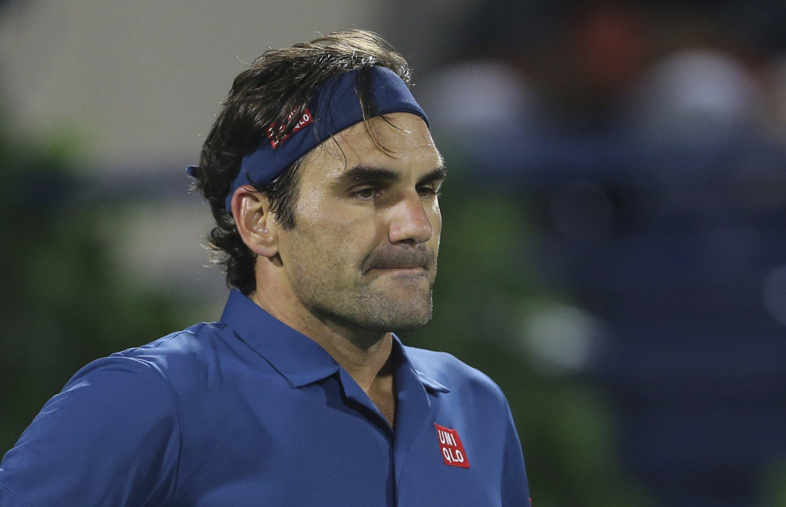 Roger Federer of Switzerland reacts during a match against Philipp Kohlschreiber of Germany at the Dubai Duty Free Tennis Championship, in Dubai, United Arab Emirates, Monday, Feb. 25, 2019. (AP Photo/Kamran Jebreili)