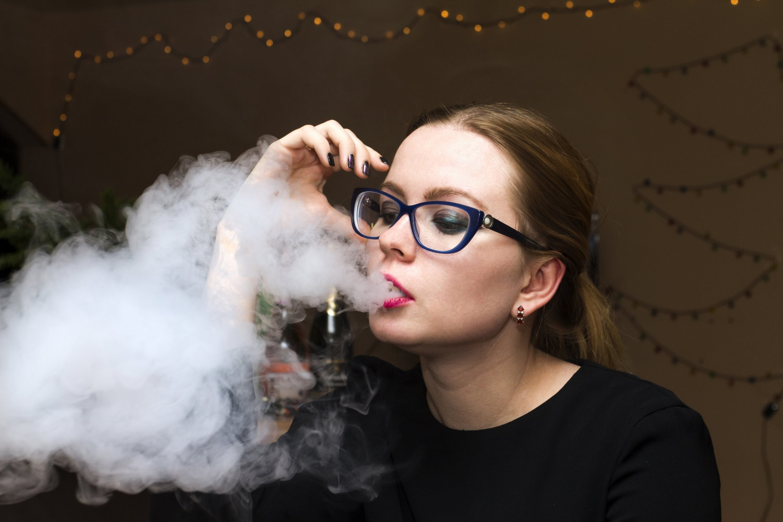 Vape girl with red lips in black dress; Shutterstock ID 547005034; Purchase Order: -