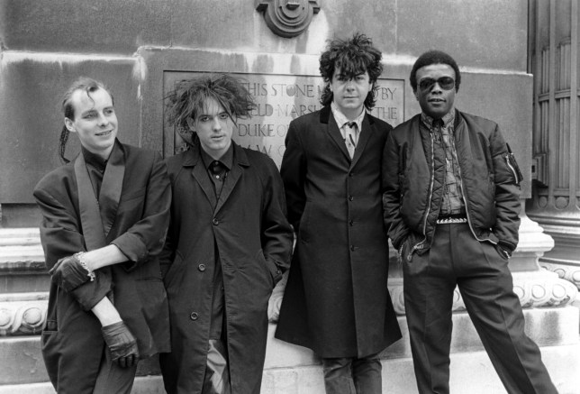 "The Cure - Paul ""Porl"" Thompson, Robert Smith, Lol Tolhurst And Clifford Leon Anderson, Covent Garden - 1984, The Cure - Paul ""Porl"" Thompson, Robert Smith, Lol Tolhurst And Clifford Leon Anderson, Covent Garden - 1984 (Photo by Brian Rasic/Getty Images)"