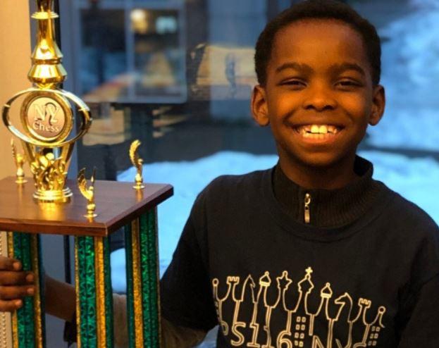 Homeless boy, 8, who lives in shelter wins prestigious chess championship