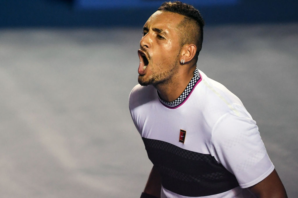 Australian tennis player Nick Kyrgios celebrates his victory after beating Spanish tennis player Rafael Nadal during their Mexico ATP 500 Open men's single tennis match in Acapulco, Guerrero state, Mexico