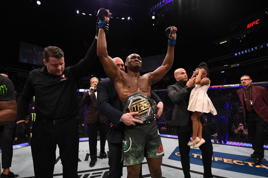 New UFC champion Kamaru Usman smashed Tyron Woodley on a fractured foot