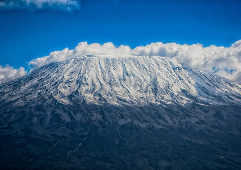 How high is Mount Kilimanjaro, where is it and how long does it take to climb?