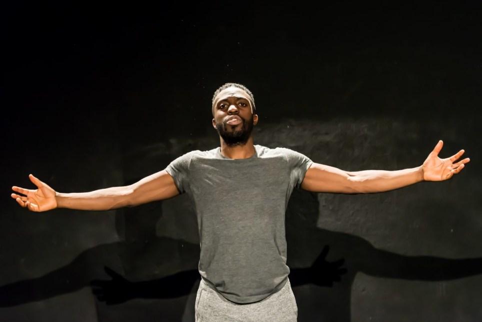 Lanre Malaolu performing on stage