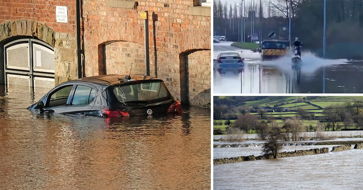 Man jet-skis on flooded roads after Britain is battered by rain and hail