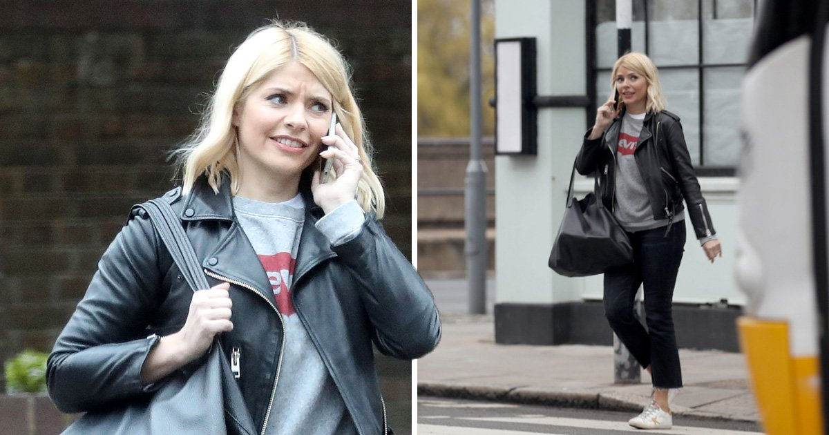 Holly Willoughby looks unimpressed on the phone amid speculation she's moving
