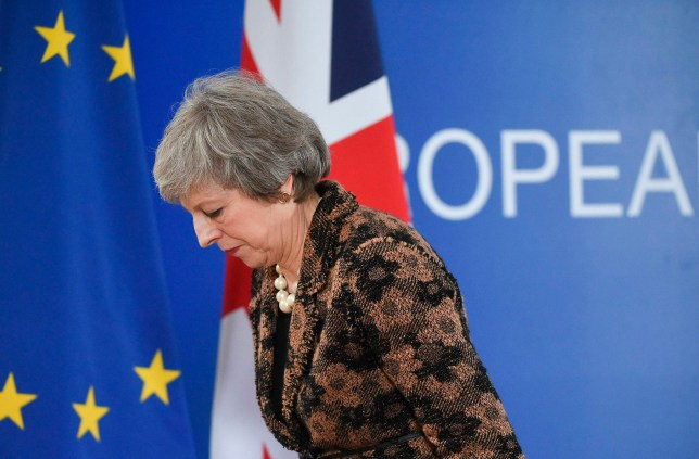Theresa May leaves after speaking during a press conference