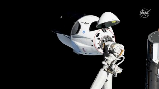 The SpaceX Crew Dragon capsule approaches the International Space Station March 3, 2019. NASA/Handout via REUTERS REUTERS ATTENTION EDITORS - THIS IMAGE WAS PROVIDED BY A THIRD PARTY.