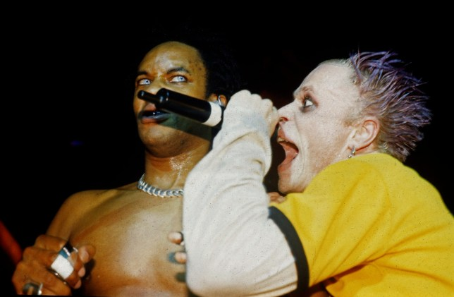 Keith Flint and Maxim of the Prodigy perform on stage, United Kingdom, 1997. (Photo by Martyn Goodacre/Getty Images)
