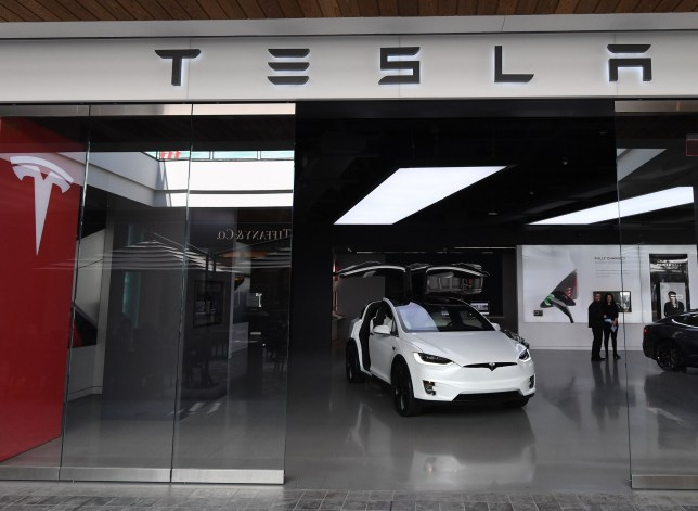 "Tesla cars on sale at a shopping mall showroom after the company indicated it would be closing showrooms and in the future selling its cars online in Los Angeles, California on March 4, 2019. - Tesla is planning to unveil a new electric ""crossover"" vehicle March 14 which is slightly bigger and more expensive than its most affordable model, according to chief executive Elon Musk. The news comes shortly after Tesla unveiled its lowest-priced Model 3, an electric car designed for the masses, at a base price of $35,000, with deliveries promised within one month. (Photo by Mark RALSTON / AFP)MARK RALSTON/AFP/Getty Images"