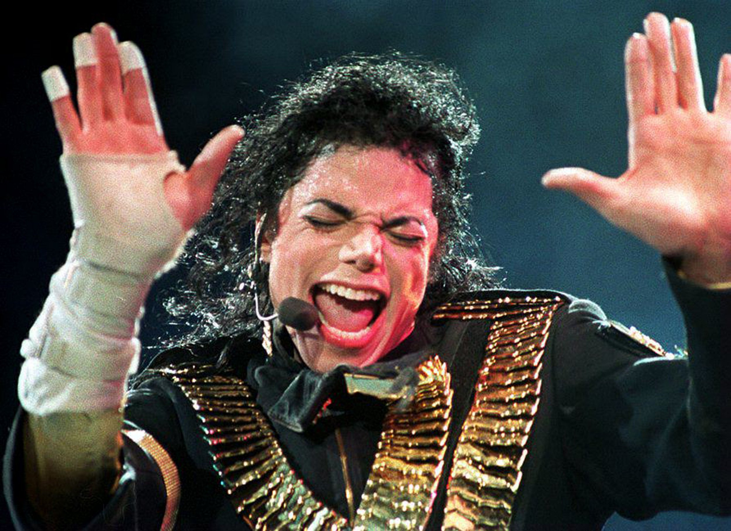 """(FILES) In this file photo taken on August 31, 1993, US pop megastar Michael Jackson performs during his """"Dangerous"""" tour in Singapore. - Celebrity talk show host Oprah Winfrey waded into the Michael Jackson debate March 4, 2019, hosting an hour-long interview of the men who say the late superstar sexually abused them as minors. The special aired on HBO after the conclusion of the network's presentation of a bombshell four-hour documentary entitled """"Leaving Neverland,"""" which has thrown the late Jackson's legacy into question nearly a decade after his death. Calling sexual abuse """"a scourge on humanity,"""" Winfrey said """"this moment transcends Michael Jackson. It's much bigger than any one person."""" (Photo by STR / AFP)STR/AFP/Getty Images"""