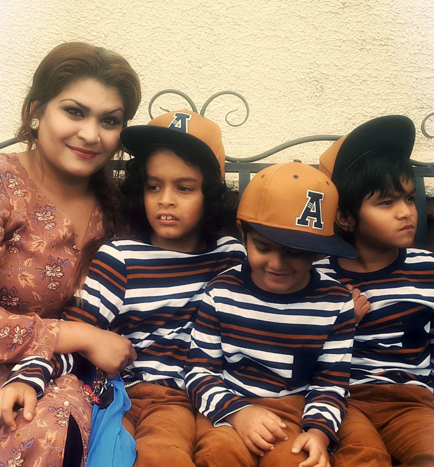 Pic by Caters News - (Pictured: Laksuma Begum with her sons Caius, eight, Kyan, seven, and Sammy, five ) - A desperate single mum has shared shocking videos revealing her daily struggle raising three severely autistic kids and claims she gets no help from the authorities. High school supply teacher Laksuma Begum, 32, from Somerton, Newport, Wales, spends her time cleaning, cooking and taking care of sons non-verbal sons Caius, eight, Kyan, seven, and Sammy, five. Shocking footage shows the boys grabbing Laksumas hair until she cries, tugging at curtains and screaming. The mum claims she has been seeking help from Newport City Council for respite care to help with her angels in disguise since 2015 and has even called the police in her desperation but has received only two hours of support a week. SEE CATERS COPY