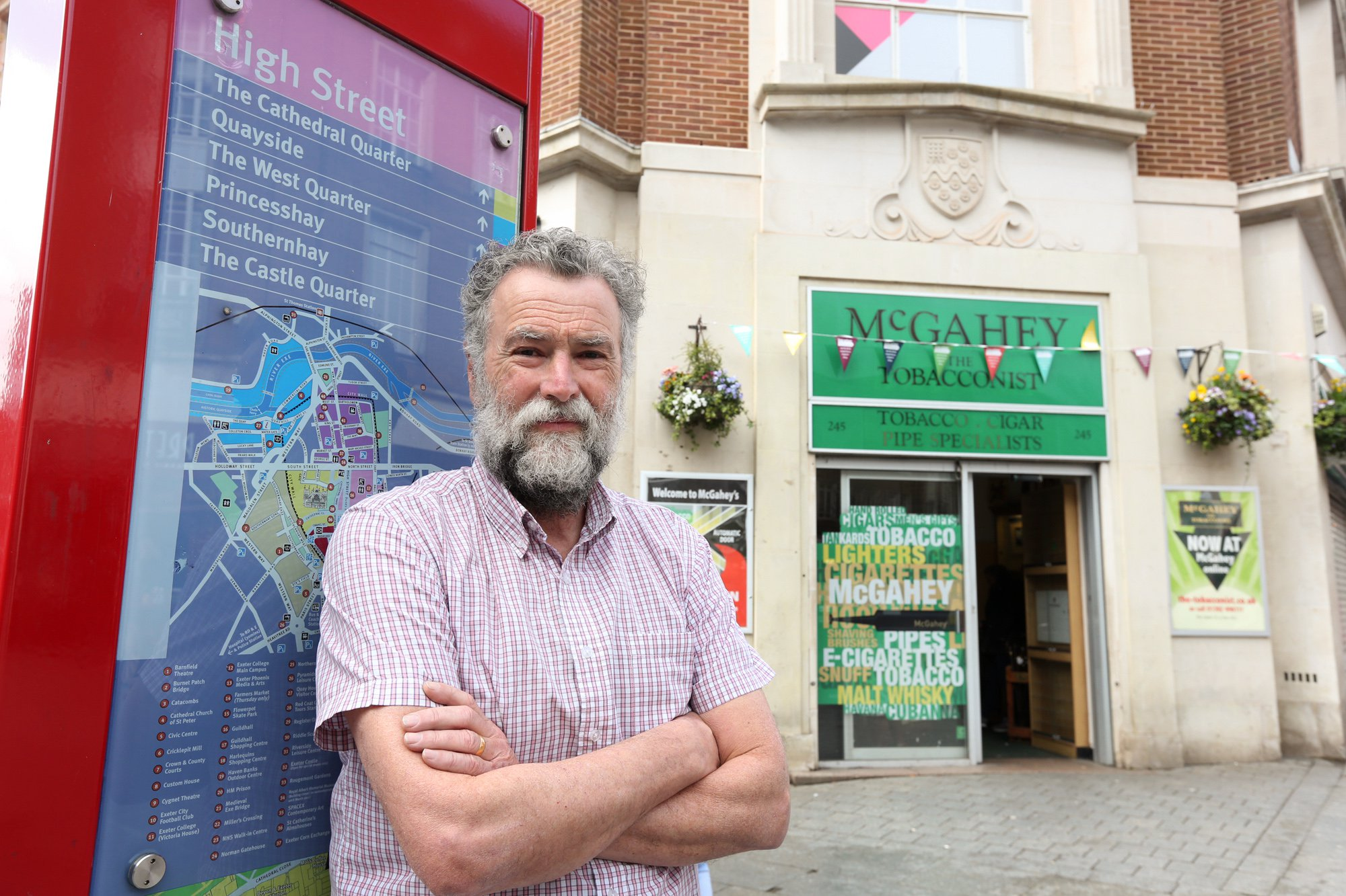 """PIC: APEX 06/03/2019 Over a century of high street history ended on Wednesday when a city's last independent shop closed for good. Tobacconist McGahey???s shut its doors for the final time in Exeter, Devon after 140 years in business. Martin McGahey, 63 said he had been involved with the business which will continue to run online since childhood. McGahey's The Tobacconist is Exeter High Street's only independent retailer and has sold tobacco for 140 years. Martin said it is the end of a family relationship with Exeter. ???It???s a very sad day. I felt the weight of four generations today."""" This picture shows Martin McGahey outside the store in Exeter. SEE STORY BY APEX NEWS - 01392 823144 ---------------------------------------------------- APEX NEWS AND PICTURES NEWS DESK: 01392 823144 PICTURE DESK: 01392 823145"""