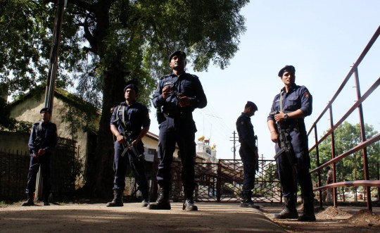 Indian police personnel stand alert at the entrance to Central Jail in Nagpur on July 29, 2015, where 1993 Mumbai blast convict Yakub Memon is currently detained. India's top court has rejected a final appeal by Yakub Memon, a key plotter of bomb attacks that killed hundreds in Mumbai in 1993, paving the way for his execution. Media reports said Yakub Memon would hang on July 30 -- more than two decades after the deadliest attacks ever to hit India -- after the Supreme Court rejected his final plea. AFP PHOTO/STR (Photo credit should read STRDEL/AFP/Getty Images)