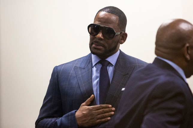 Musician R. Kelly arrives at the Daley Center for a hearing in his child support case at the Daley Center, Wednesday, March 6, 2019, in Chicago. Kelly was charged last month with sexually abusing four females dating back to 1998, including three underage girls. He's pleaded not guilty. (Ashlee Rezin/Chicago Sun-Times via AP)
