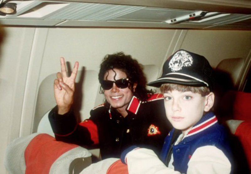 Michael Jackson with a young boy