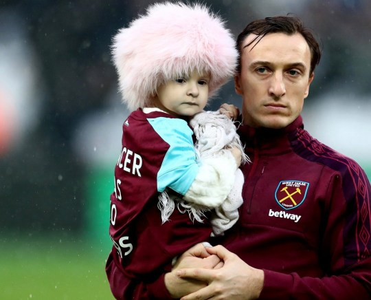 LONDON, ENGLAND - JANUARY 20: Mark Noble of West Ham United holds Isla Caton as he lines up prior to the Premier League match between West Ham United and AFC Bournemouth at London Stadium on January 20, 2018 in London, England. (Photo by Catherine Ivill/Getty Images)