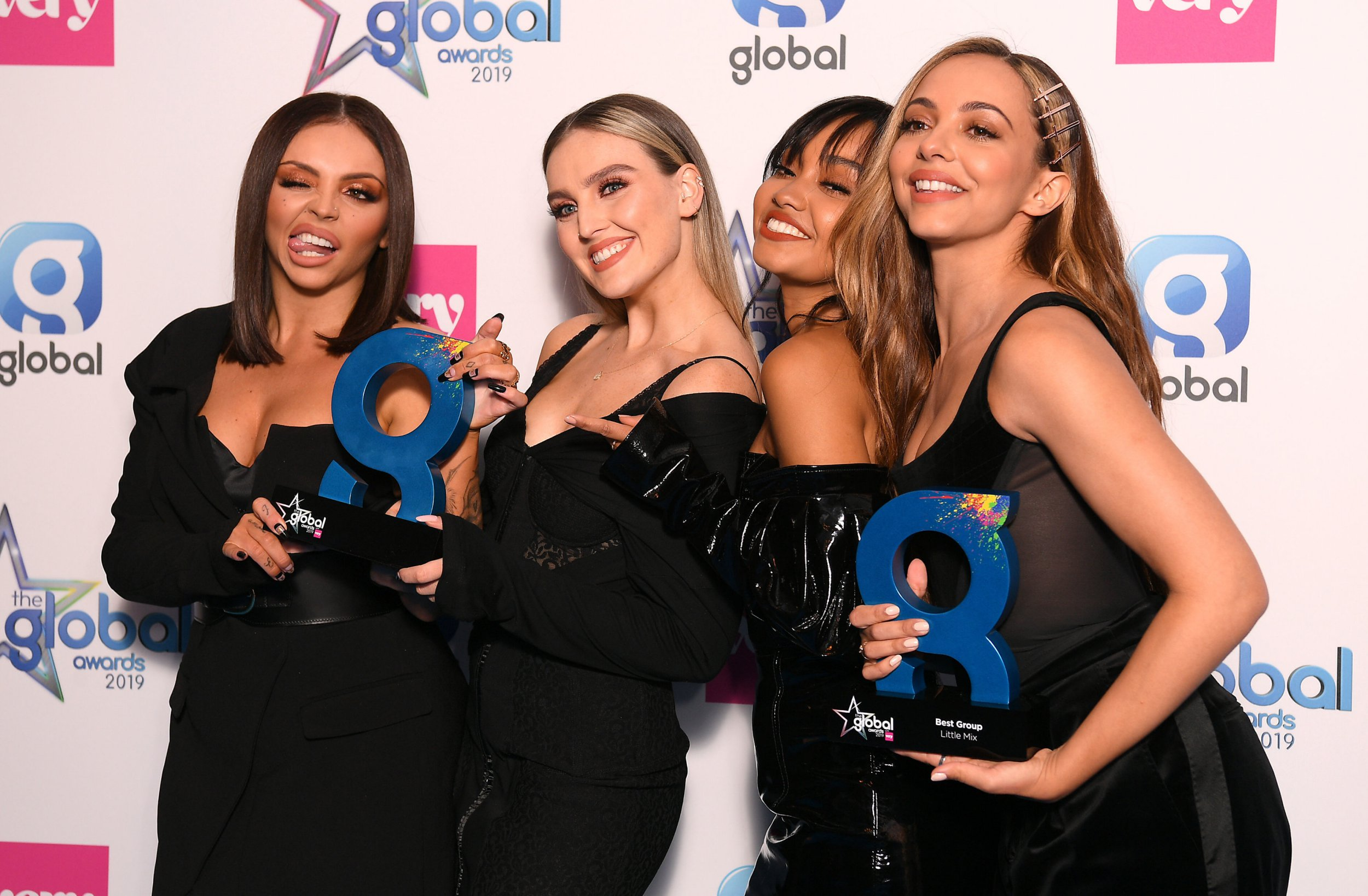Jesy Nelson, Perrie Edwards, Leigh-Anne Pinnock, and Jade Thirlwall of Little Mix wins the Best Song and Best Group award at The Global Awards 2019 with Very.co.uk held at London's Eventim Apollo Hammersmith. PRESS ASSOCIATION Photo. Picture date: Thursday March 7, 2019. See PA Story SHOWBIZ Global. Photo credit should read: Scott Garfitt/PA Wire