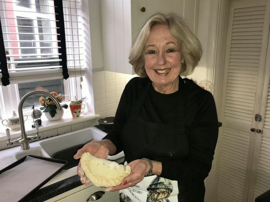 Jill Martin in her kitchen where she makes here award winning knockers. See National News story NNknockers; A gran is celebrating being a world champion after her meaty knockers scooped first prize in a pasty contest. Retired gran Jill Martin has just returned from The World Championship Pasty Competition where she won first prize for her Betteshanger Big Breakfast Kentish Knocker. The 68-year-old's sausage, bacon and egg parcel topped The Open Savoury category - one of the two main categories of the day along with the Cornish Pasty class. Competing in the 'professional' category because she sells the Knockers at Deal's Friday and Saturday markets, she beat off competition from hundreds of others including businesses and bakeries.