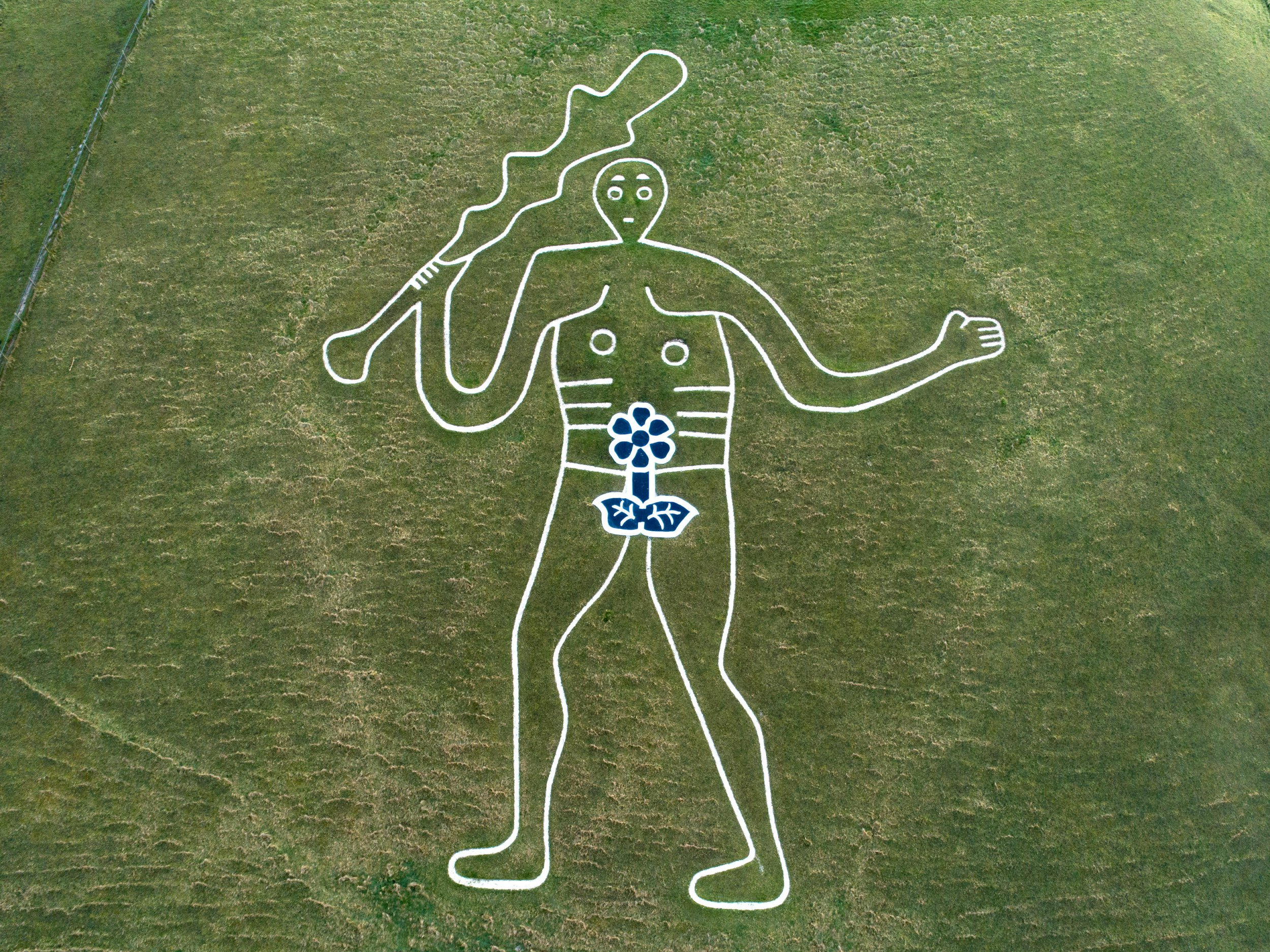 Alamy Live News. RWYA90 Cerne Abbas, Dorset, UK. 8th March, 2019. To celebrate International Women?s Day 2019 a team of anonymous ?guerilla artists? working through the night have temporarly turned the Cerne Abbas Giant?s 9 metre penis into a 9 metre flower. This humorous temporary enrichment and transformation into a flower is not a call for a permanent change to the chalk creation but an invitation to begin peaceful discussions about relationships within society and hopefully creating equality. Gordon Scammell/Jay Enticknap/Live News This is an Alamy Live News image and may not be part of your current Alamy deal . If you are unsure, please contact our sales team to check.