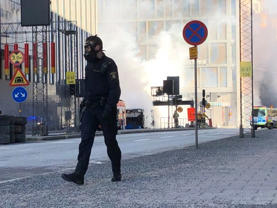 The site where a bus exploded and caught fire is seen in Tegelbacken in central Stockholm, Sweden March 10, 2019. Tomas Bengtsson/TT News Agency/via REUTERS ATTENTION EDITORS - THIS IMAGE WAS PROVIDED BY A THIRD PARTY. SWEDEN OUT. NO COMMERCIAL OR EDITORIAL SALES IN SWEDEN.