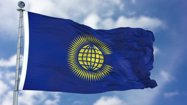 Commonwealth of Nations flag waving against clear blue sky, close up, isolated with clipping path mask luma channel, perfect for film, news, composition