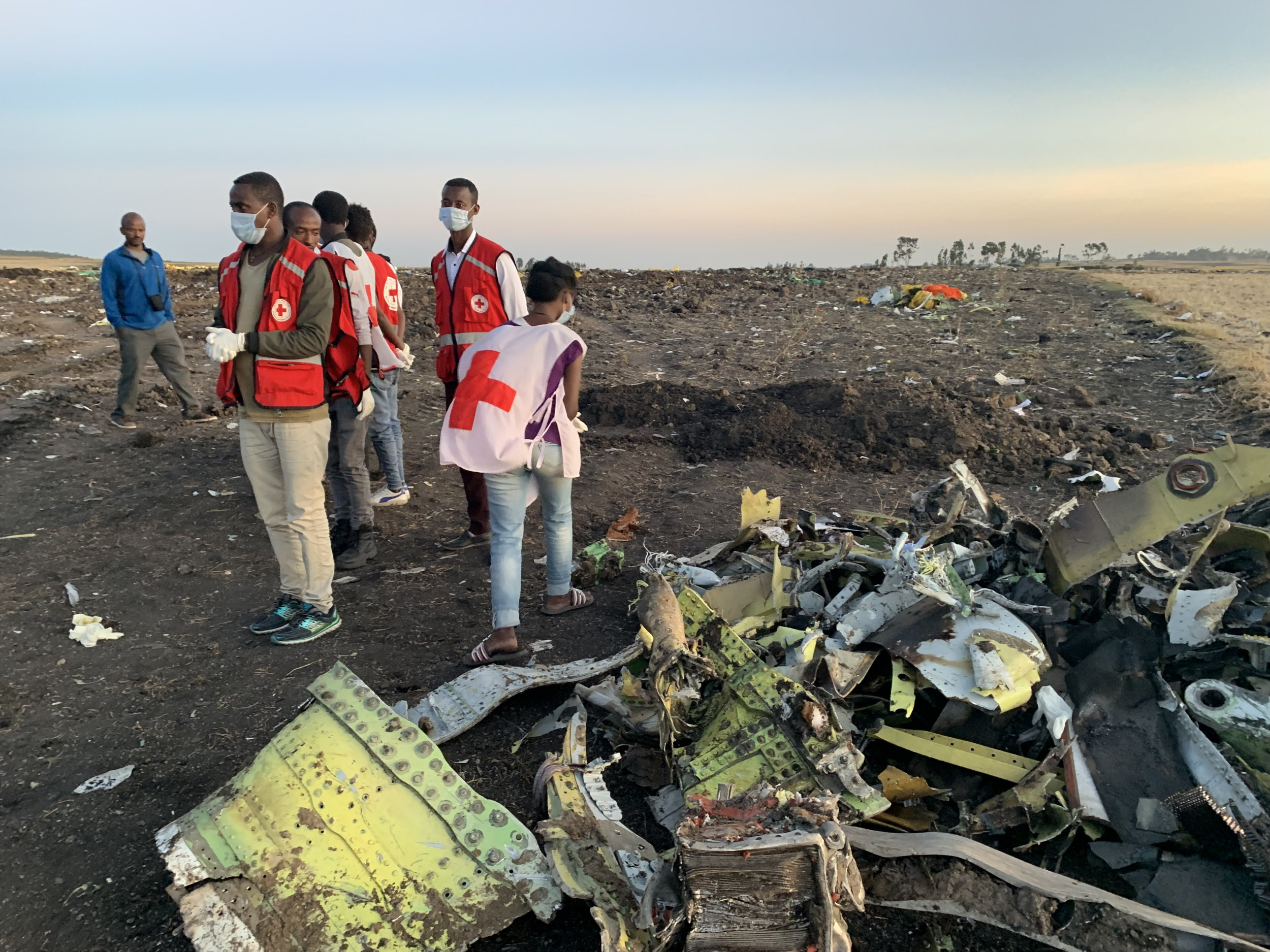 (190310) -- ADDIS ABABA, March 10, 2019 (Xinhua) -- Rescuers work beside the wreckage of an Ethiopian Airlines' aircraft at the crash site, some 50 km east of Addis Ababa, capital of Ethiopia, on March 10, 2019. All 157 people aboard Ethiopian Airlines flight were confirmed dead as Africa's fastest growing airline witnessed the worst-ever incident in its history. The incident on Sunday, which involved a Boeing 737-800 MAX, occurred a few minutes after the aircraft took off from Addis Ababa Bole International Airport to Nairobi, Kenya. It crashed around Bishoftu town, the airline said. (Xinhua/Wang Shoubao) PHOTOGRAPH BY Xinhua / Barcroft Images