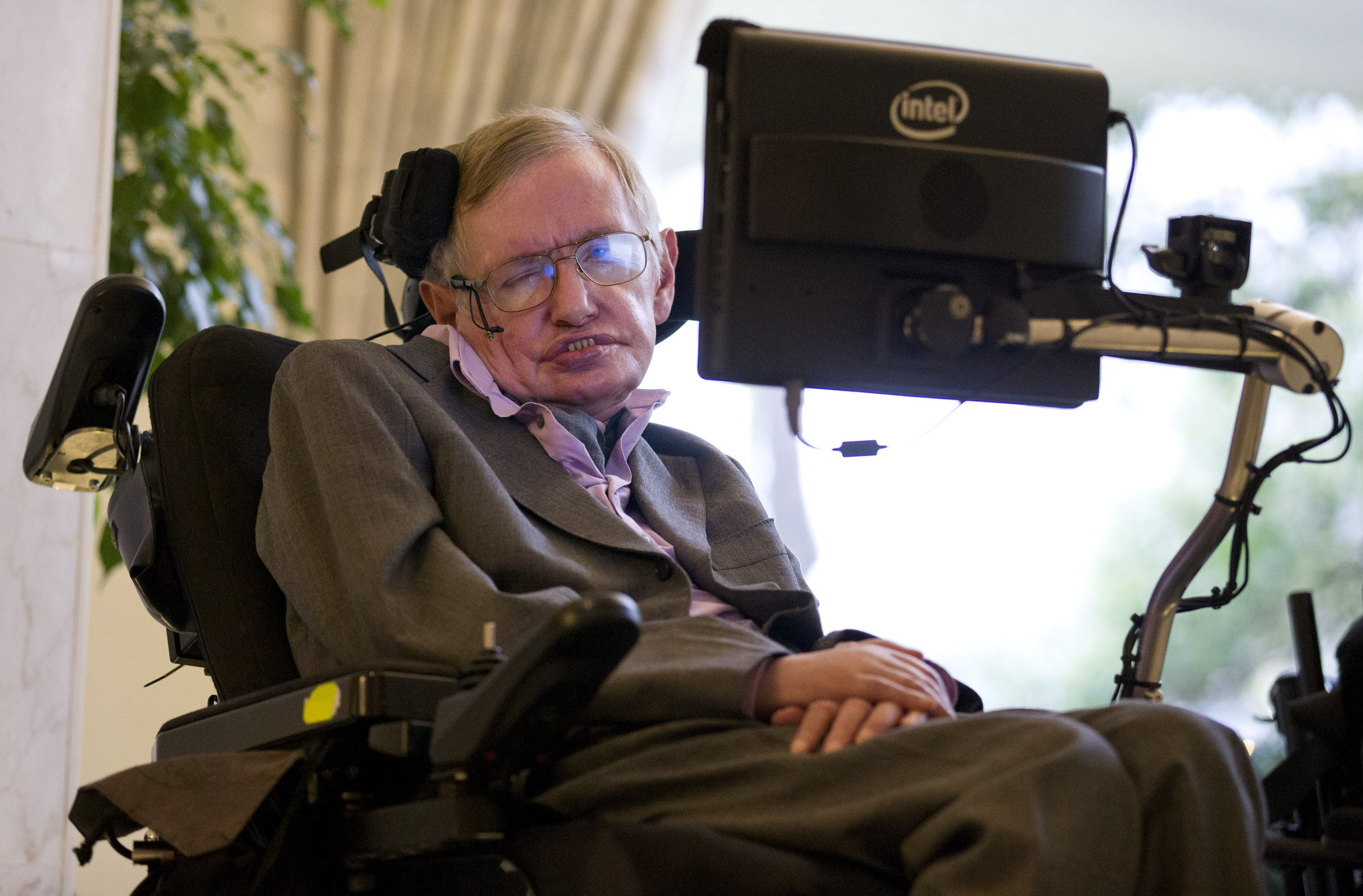 """British theoretical physicist professor Stephen Hawking speaks to members of the media at a press conference in London on December 2, 2014. The system that helps Stephen Hawking communicate with the outside world will be made available online from January in a move that could help millions of motor neurone disease sufferers, scientists said Tuesday. The wheelchair-bound theoretical physicist, who shot to international fame in the 1980s with his book """"A Brief History of Time"""", hailed the decision by US tech giant Intel at a press conference in London. AFP PHOTO / JUSTIN TALLIS (Photo credit should read JUSTIN TALLIS/AFP/Getty Images)"""
