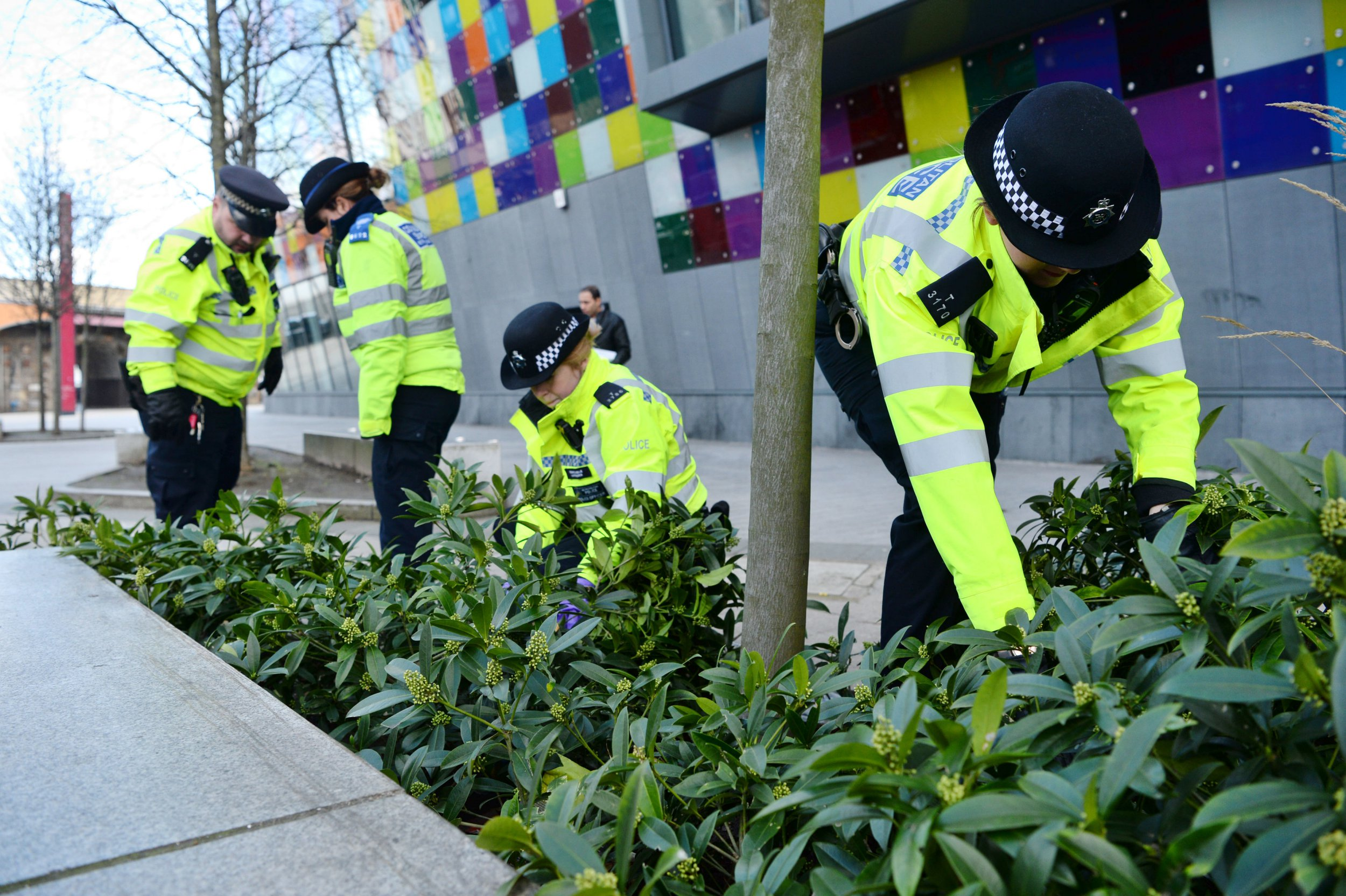 Officers from the Metropolitan Police search for knives outside the Glass Mill Centre in Lewisham, south London, as part of Operation Sceptre, which will see forces across England and Wales using surrender bins, stop-and-search and weapons sweeps in a concerted crackdown on knife crime. PRESS ASSOCIATION Photo. Picture date: Monday March 11, 2019. See PA story POLICE Knives. Photo credit should read: Kirsty O'Connor/PA Wire
