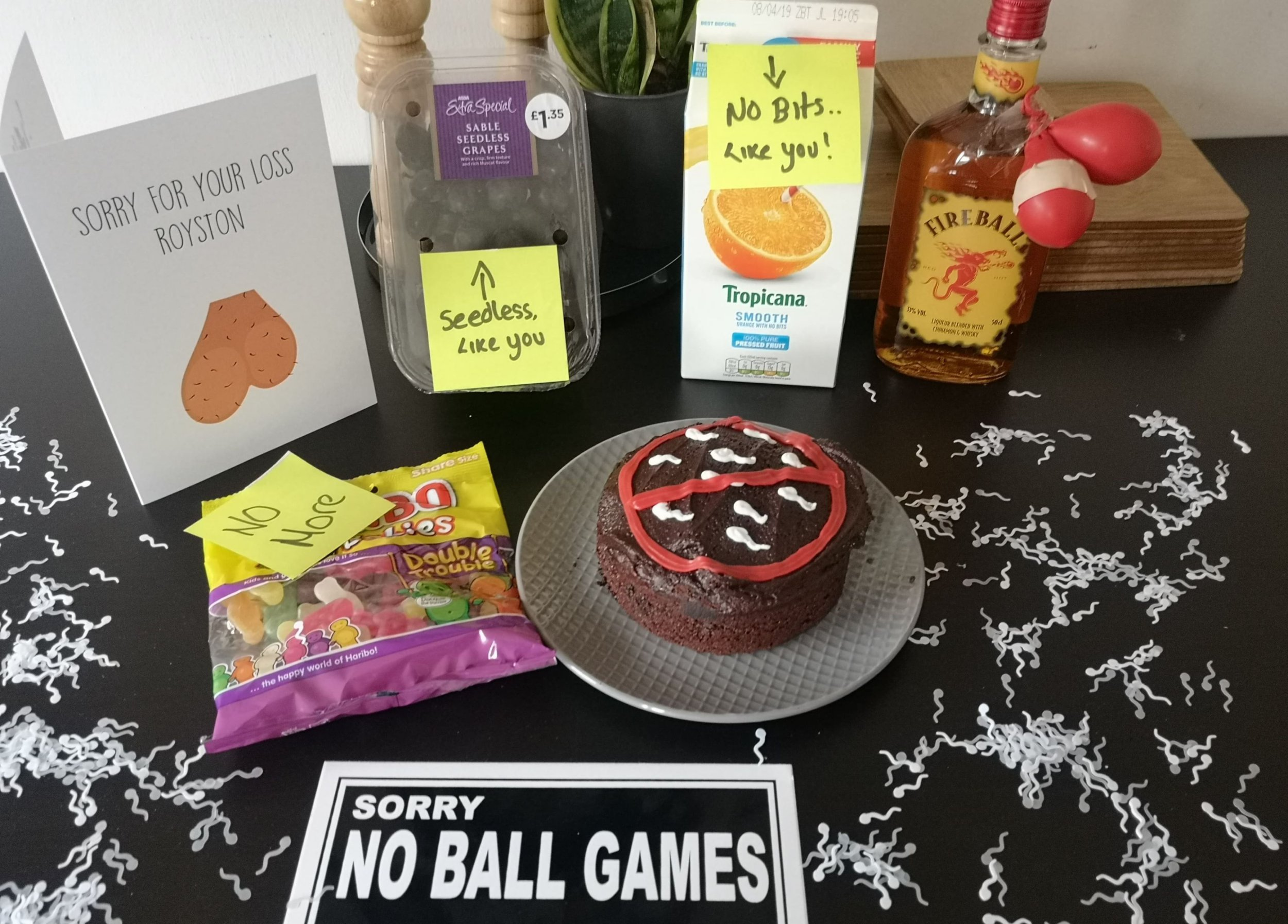 PIC FROM Kennedy News and Media (PICTURED: SOME OF THE VASECTOMY-THEMED SPREAD CHERISH ALLEN, 27, PUT ON FOR PARTNER ROYSTON SMITH, 36, AFTER HIS OP) A mum-of-three celebrated her partner???s decision to have the 'snip' by throwing a vasectomy party - complete with 'sperm' cake and meatballs while his kids wore 'swim team' t-shirts. Cherish Allen bid ???balls voyage??? to Royston Smith's reproductive abilities with a ???swimmers-themed??? bash featuring a home-made cake with sperm icing, seedless grapes and ???no bits??? orange juice. The full-time mum threw the party on Friday in recognition of factory worker Royston???s decision to ???take one for the team??? after ???completing??? their family and having three children together.