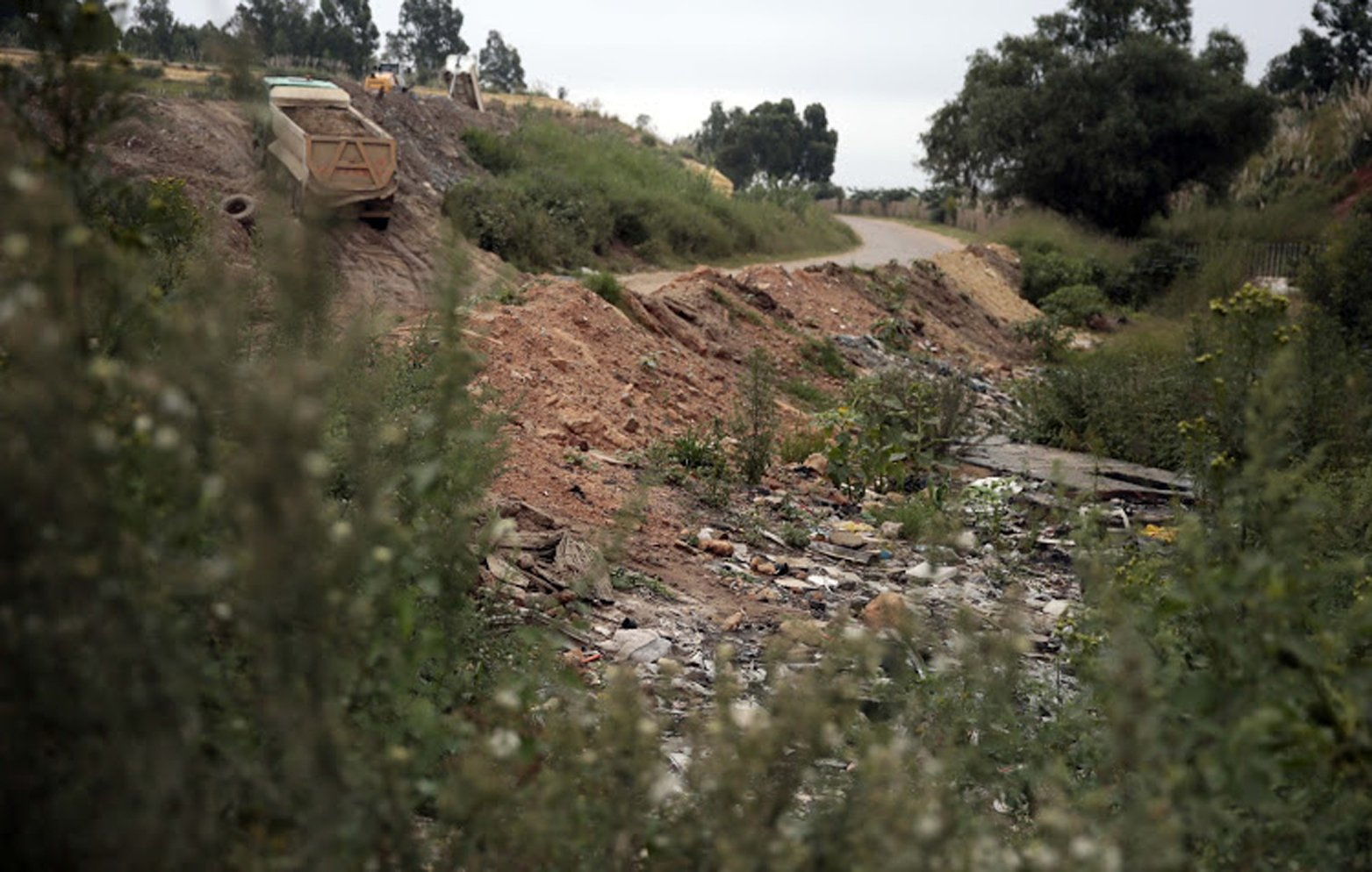 GERMISTON, SOUTH AFRICA MARCH 11: The dumpsite where a 3-year-old boys body was found after allegedly being tormented and killed by two boys, grieves on March 11, 2019 in Germiston, South Africa. Two children aged seven and eight stand accused of killing the young boy. They allegedly confessed to police how they assaulted him with stones, tied him up with a rope and pushed him over the edge of the dumpsite. (Photo by Gallo Images/Sowetan/Sebabatso Mosamo)