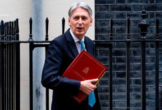 """Britain's Chancellor of the Exchequer Philip Hammond leaves from 11 Downing Street in central London on March 13, 2019, headed for the Houses of Parliament where he is set to deliver his Spring Budget update. - British MPs will vote Wednesday on whether the country should leave the EU without a deal in just over two weeks, after overwhelmingly rejecting a draft divorce agreement. The House of Commons is expected to vote against a """"no deal"""" Brexit, although this could still happen on March 29 unless it can agree on what should happen instead. (Photo by Niklas HALLE'N / AFP)NIKLAS HALLE'N/AFP/Getty Images"""