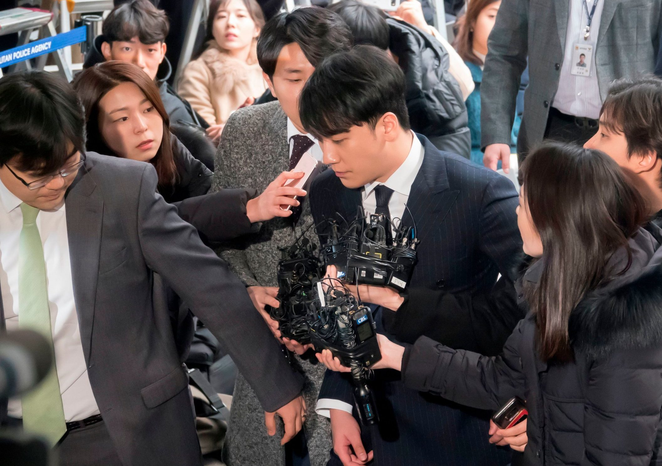 Mandatory Credit: Photo by Aflo/REX (10155579k) Lee Seung-hyun (C), a member of K-pop boy band BIGBANG, arrives at the Seoul Metropolitan Police Agency for police questioning over sex-for-favors allegations Seungri qeustioned over sex-for-favors allegations, Seoul, South Korea - 14 Mar 2019 He is accused of arranging sexual services for potential investors in a nightclub in Seoul.