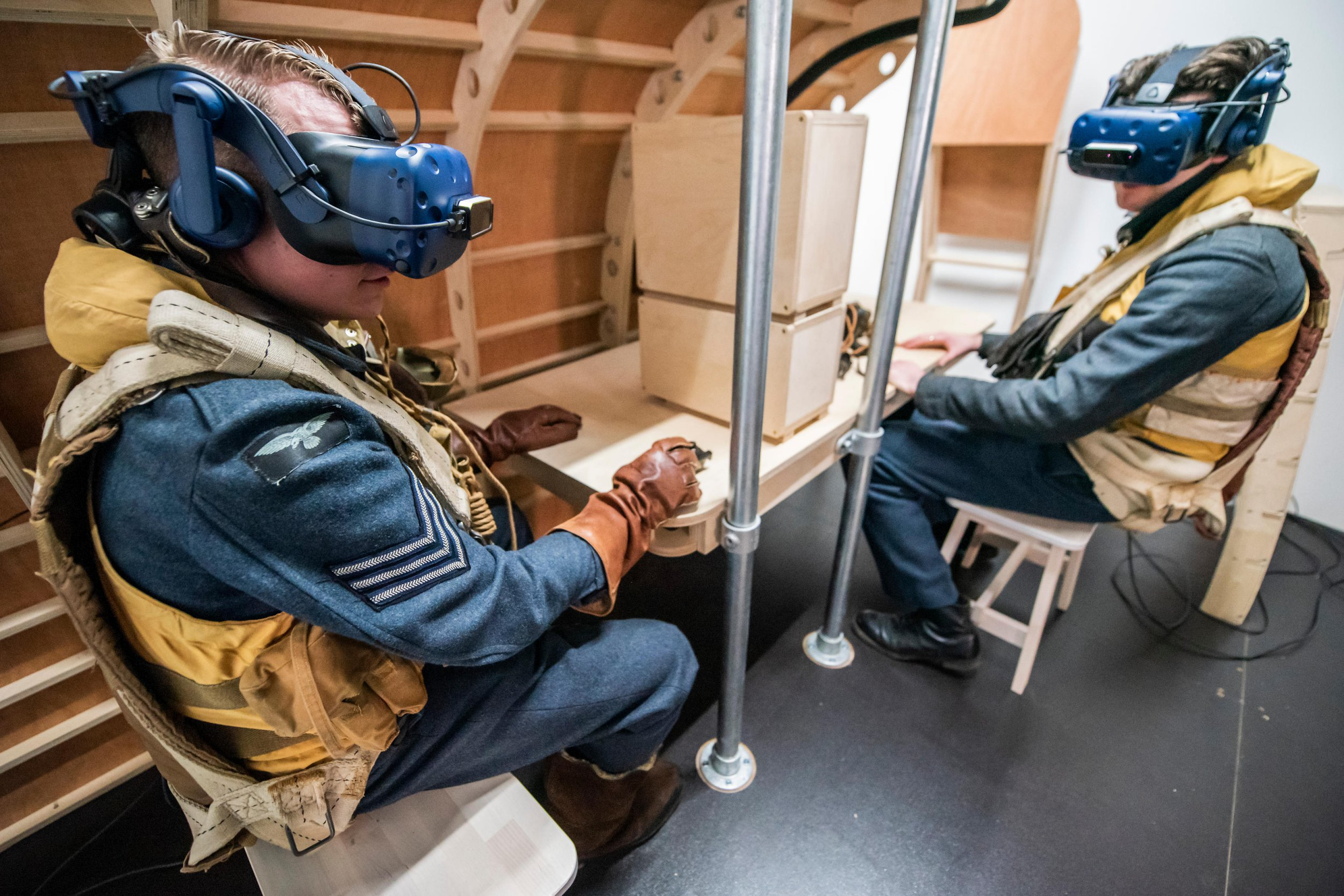 Alamy Live News. RYHMET London, UK. 14th March, 2019. Re-enactors have a go at the VR experience - Immersive Histories: Dambusters Virtual Reality Experience. An opportunity to step back in time to the early hours of 17 May 1943 and on board Avro Lancaster G-George to join the Dambusters on their legendary mission. Using the latest virtual reality and haptic technology, in conjunction with a physical 1:1 recreation of the interior of the iconic Avro Lancaster bomber. Credit: Guy Bell/Alamy Live News Credit: Guy Bell/Alamy Live News This is an Alamy Live News image and may not be part of your current Alamy deal . If you are unsure, please contact our sales team to check.