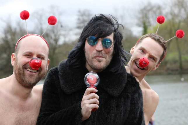 LONDON, ENGLAND - MARCH 15: Benedict Cumberbatch (R) and Noel Fielding (C) and Zander Woollcombe (L) of United Global Mental Health support Red Nose Day by swimming in cold water for Mental Health programmes on March 15, 2019 in London, England. (Photo by Neil P. Mockford/Getty Images)
