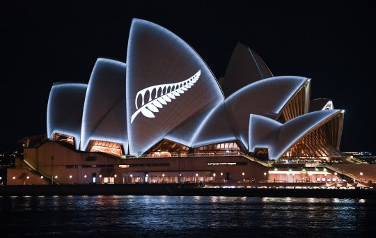 SYDNEY, AUSTRALIA - MARCH 16: A silver fern is projected onto the sails of the Opera House in commemoration of the victims of the Christchurch massacre on March 16, 2019 in Sydney, Australia. 49 people are confirmed dead, with 36 injured still in hospital following the shooting attacks on two mosques in Christchurch on Friday, 15 March. 41 of the victims were killed at Al Noor mosque on Deans Avenue and seven died at Linwood mosque. Another victim died later in Christchurch hospital. A 28-year-old Australian-born man, Brenton Tarrant, appeared in Christchurch District Court on Saturday charged with murder. The attack is the worst mass shooting in New Zealand's history. (Photo by James D. Morgan/Getty Images)