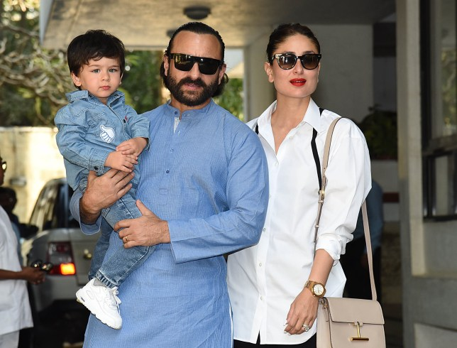 Indian Bollywood actors Saif Ali Khan (C) and Kareena Kapoor with their son Taimur Ali Khan arrives for a Christmas brunch in Mumbai on December 25, 2018. (Photo by Sujit Jaiswal / AFP) (Photo credit should read SUJIT JAISWAL/AFP/Getty Images)