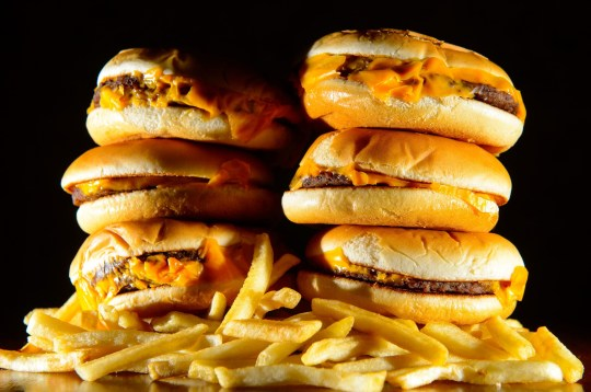 """File photo dated 9/7/2014 of a pile of cheeseburgers and french fries. Junk food adverts on TV and online could be banned before 9pm as part of Government plans to fight the """"epidemic"""" of childhood obesity. PRESS ASSOCIATION Photo. Issue date: Sunday March 17, 2019. Plans for the new watershed have been put out for public consultation in a bid to combat the growing crisis, the Department of Health and Social Care (DHSC) said. See PA story HEALTH Adverts. Photo credit should read: Dominic Lipinski/PA Wire"""