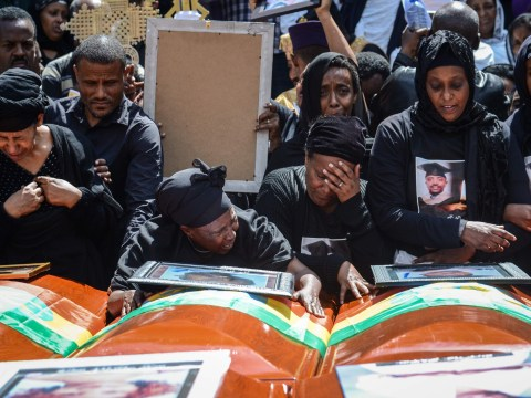Empty coffins carried by families at mass funeral of Ethiopia crash victims