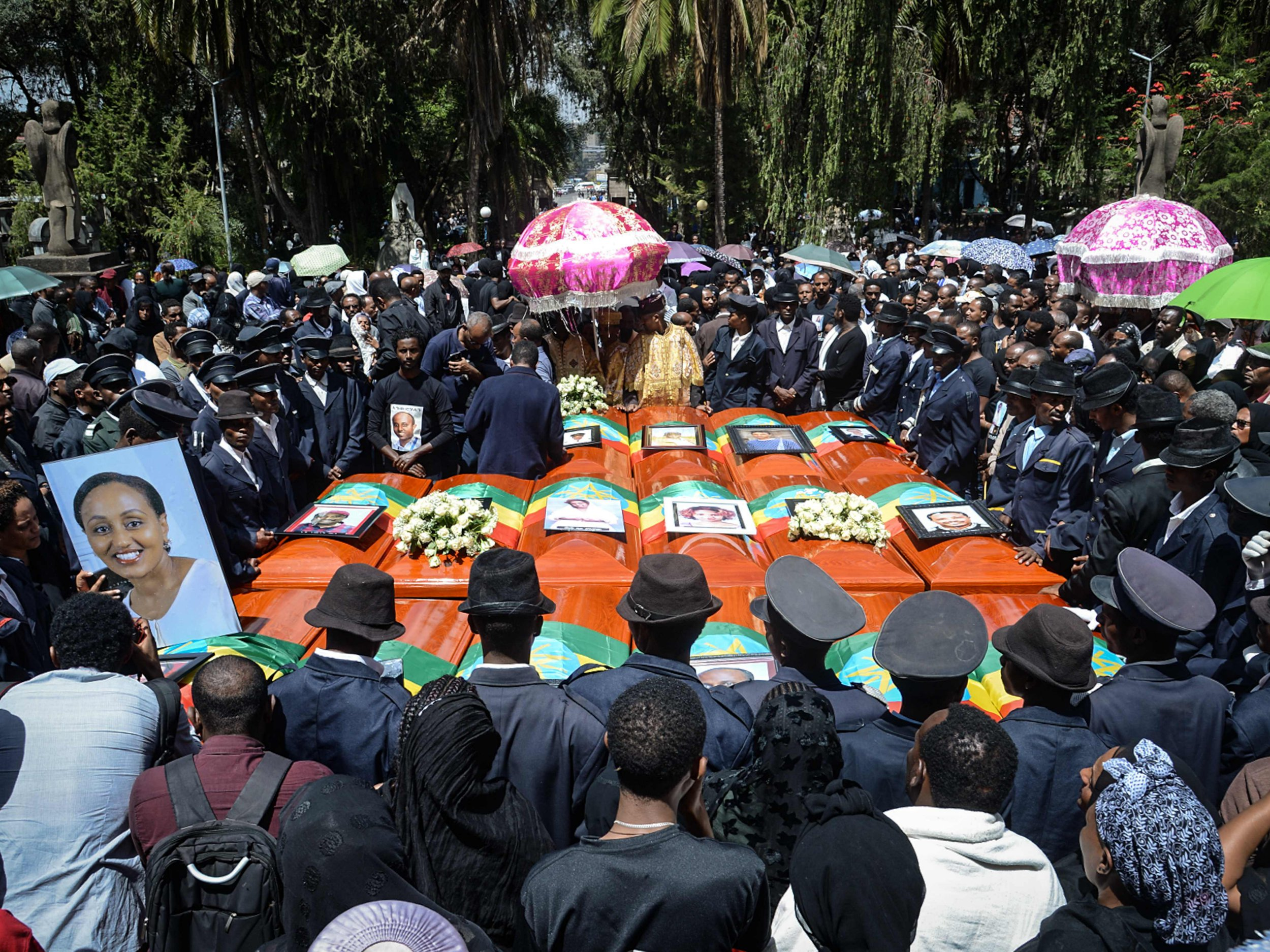 TOPSHOT - Coffins of victims of the crashed accident of Ethiopian Airlines are gathered during the mass funeral at Holy Trinity Cathedral in Addis Ababa, Ethiopia, on March 17, 2019. - The crash of Flight ET 302 minutes into its flight to Nairobi on March 10 killed 157 people onboard and caused the worldwide grounding of the Boeing 737 MAX 8 aircraft model involved in the disaster. (Photo by Samuel HABTAB / AFP)SAMUEL HABTAB/AFP/Getty Images