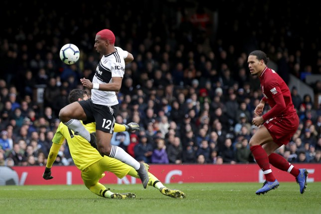 Fulham's Ryan Babel capitalises on a mistake by Liverpool goalkeeper Alisson Becker and Virgil van Dijk to score his side's first goal of the game