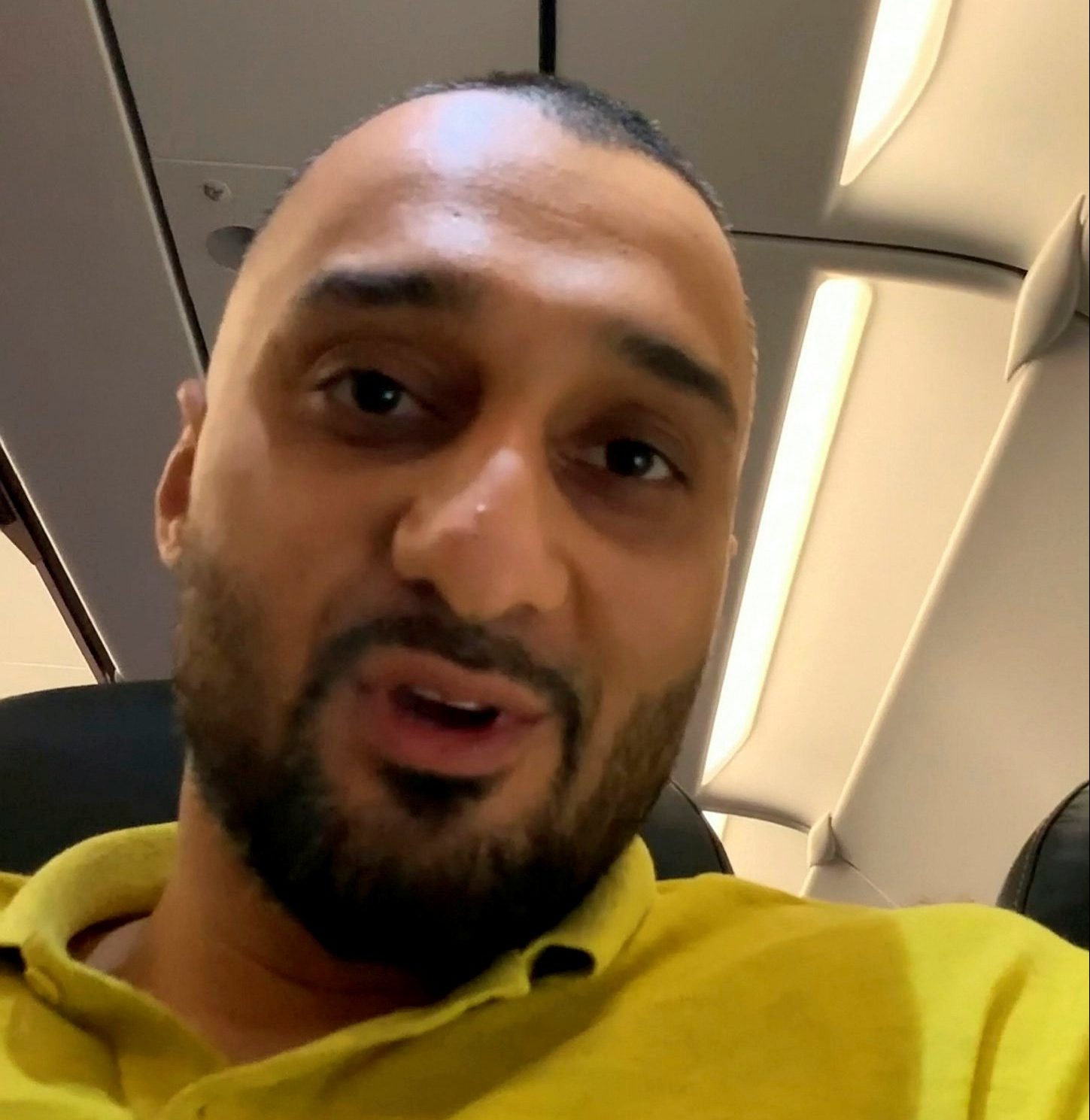 """Video grab of Adil Kayani, 35, talking to air cabin crew after a steward burst in on him on the toilet on an Easyjet flight from Marrakesh to Manchester .See SWNS story SWTPflight. An airline passenger was offered ?500 and an apology after a steward burst in on him using the toilet mid-flight.Adil Kayani, 35, was left red-faced when an EasyJet steward barged in on him whilst he was sat on the loo, with his trousers around his ankles.EasyJet said staff did it for ?safety and security reasons? after Adil had been in there for more than 15 minutes.But Adil said he was mortified and was left """"exposed"""" after the male staff member unlocked the door from the outside, two hours into a flight from Marrakesh."""