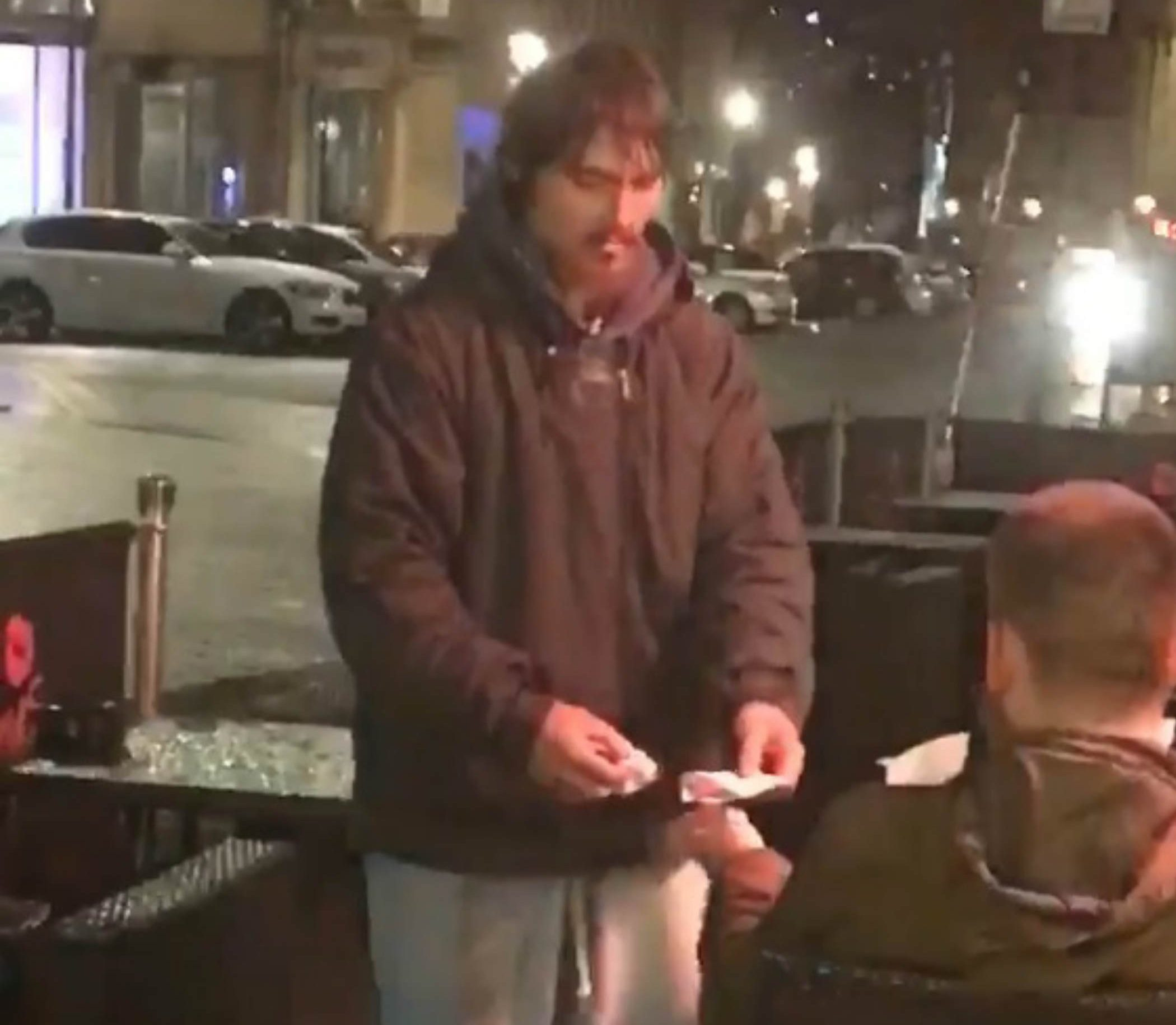 """HEART-WARMING video shows a samaritan giving a """"homeless man"""" his bank card, to withdraw money out for himself. The man, with a beard and jacket, can be seen returning to a helpful punter with his receipt and ?20 after being given the card along with its PIN number. He then shakes the hand of the man, who is sat outside at Harry?s Bar and Restaurant, on Grey Street, Newcastle-upon-Tyne. The clip was taken by Jack Fada, from Newcastle-upon-Tyne, as he took a break"""