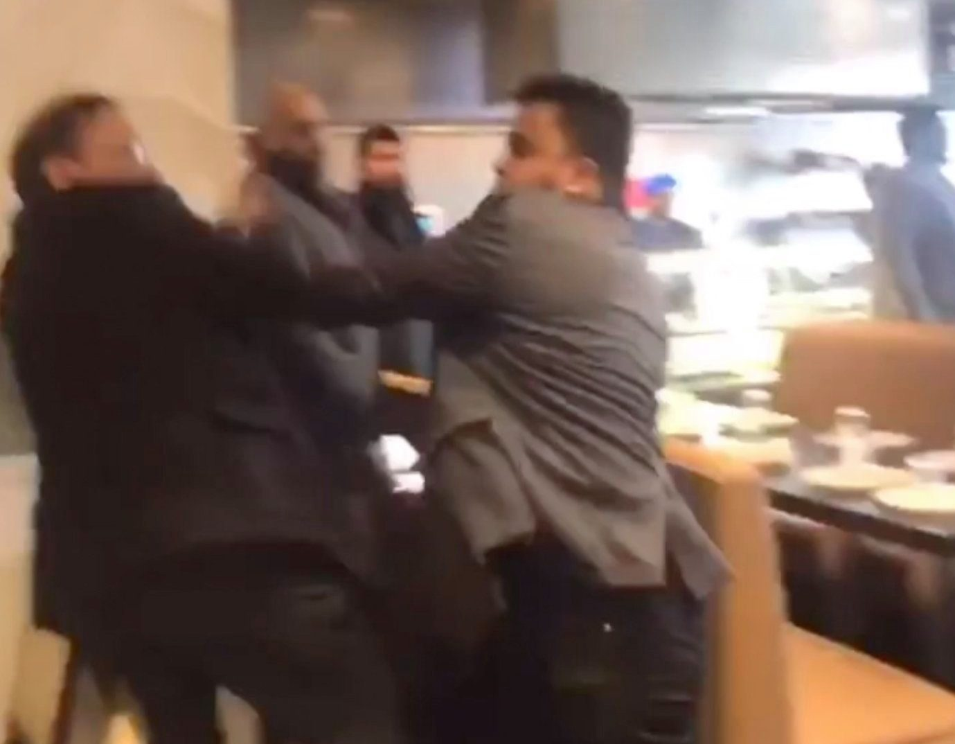 A fist fight breaks out inside Dawat restaurant during a mass brawl which led to a man being stabbed this morning in Southall, London, Monday 18th March, 2019. SHOCKING footage has emerged of the mass brawl which ended in a STABBING which left seven people injured in a restaurant in West London this morning. The terrifying brawl ? which turned into a knife fight ? was filmed inside Dawat Restaurant on The Broadway, Southall this morning. Police were called to The Broadway shortly after 11am and found a man in his 20s with a slash injury, who was taken to hospital. Paramedics said seven people were treated for injuries with three of those rushed to hospital. At least two people have been arrested and officers currently believe two groups were involved. The horrifying footage was filmed by a person who was eating at Dawat restaurant with their mother and sister this morning. In the clip, the men can be seen punching each other and throwing chairs across the restaurant. The individual ? who wishes to remain anonymous ? said they were terrified by the brawl that ensued in the restaurant. ... SEE COPY AND VID ... PIC BY NEWS DOG MEDIA ... 0121 517 0019 ... pictures@newsdogmedia.co.uk