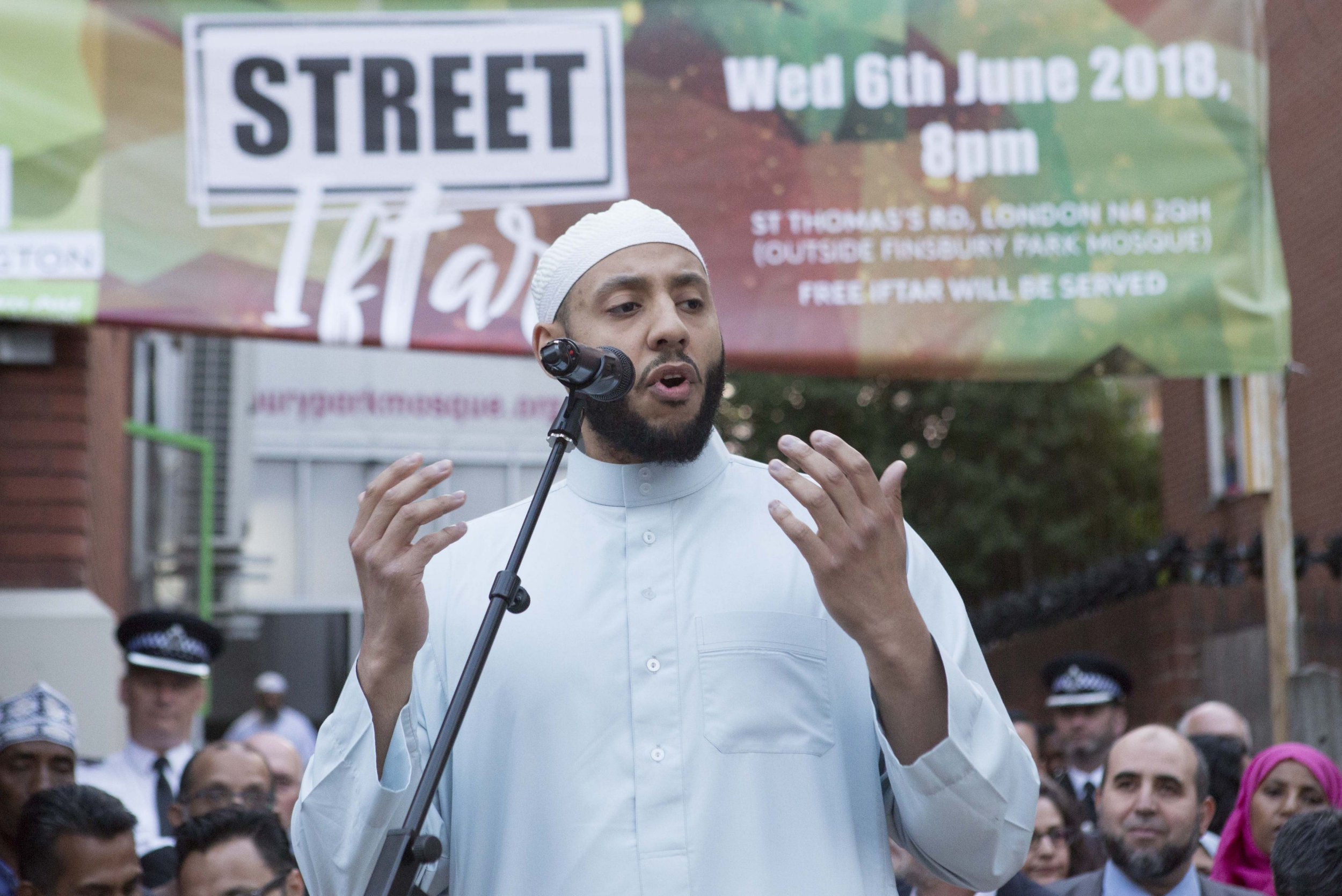 Imam Mohammed Mahmoud joins supporters as he makes a speech to celebrate community spirit one year after the Finsbury Park terrorist attack.