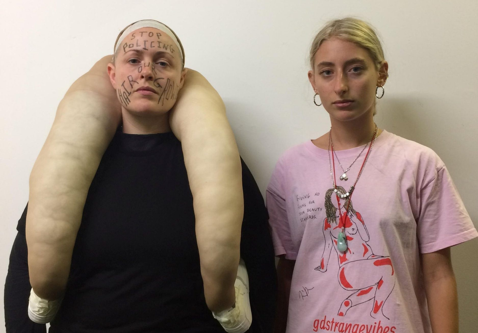 Artist puts legs around model's neck to protest the pressure to get rid of pubes