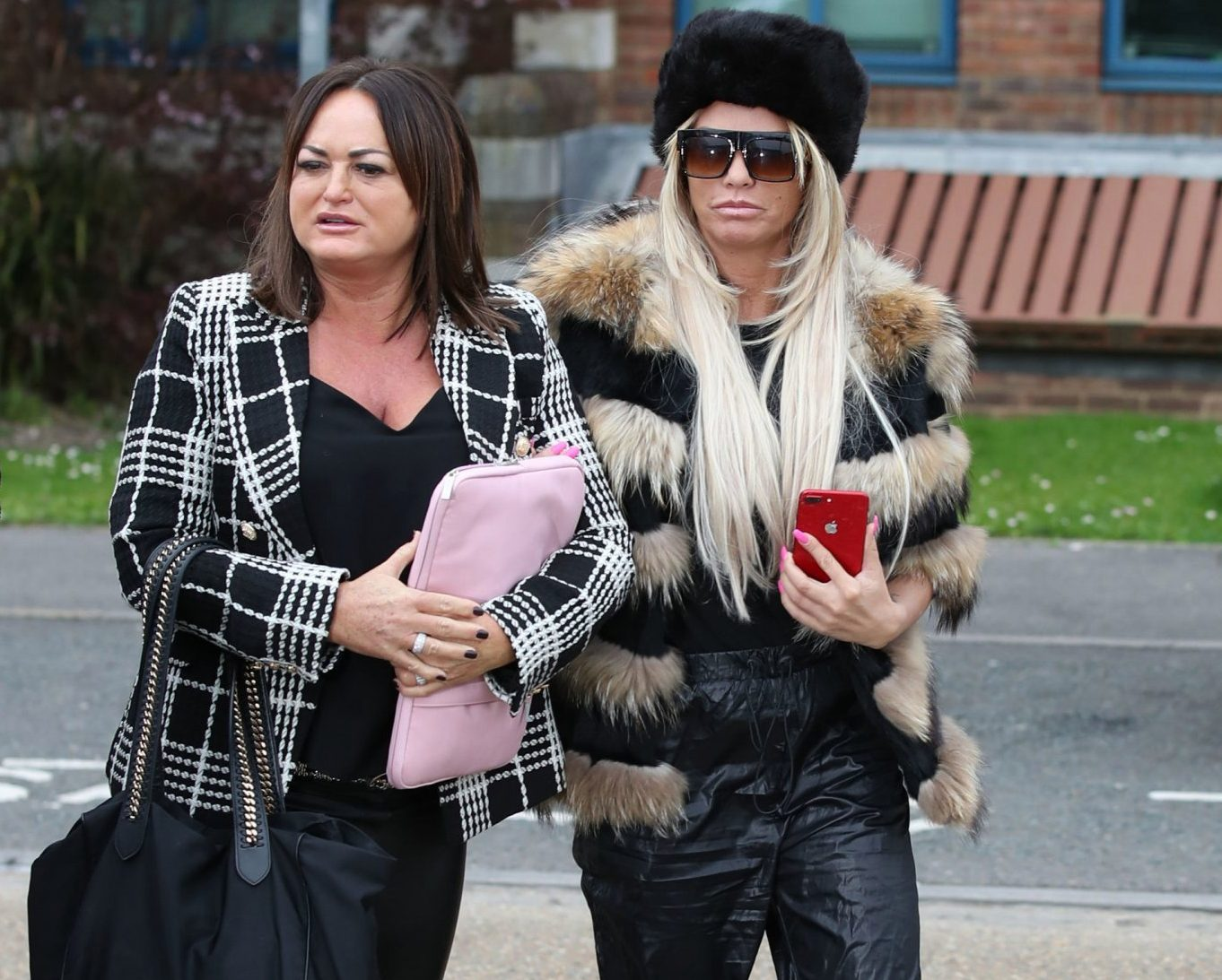 Katie Price rocks a whole lot of fur as she finally turns up to court