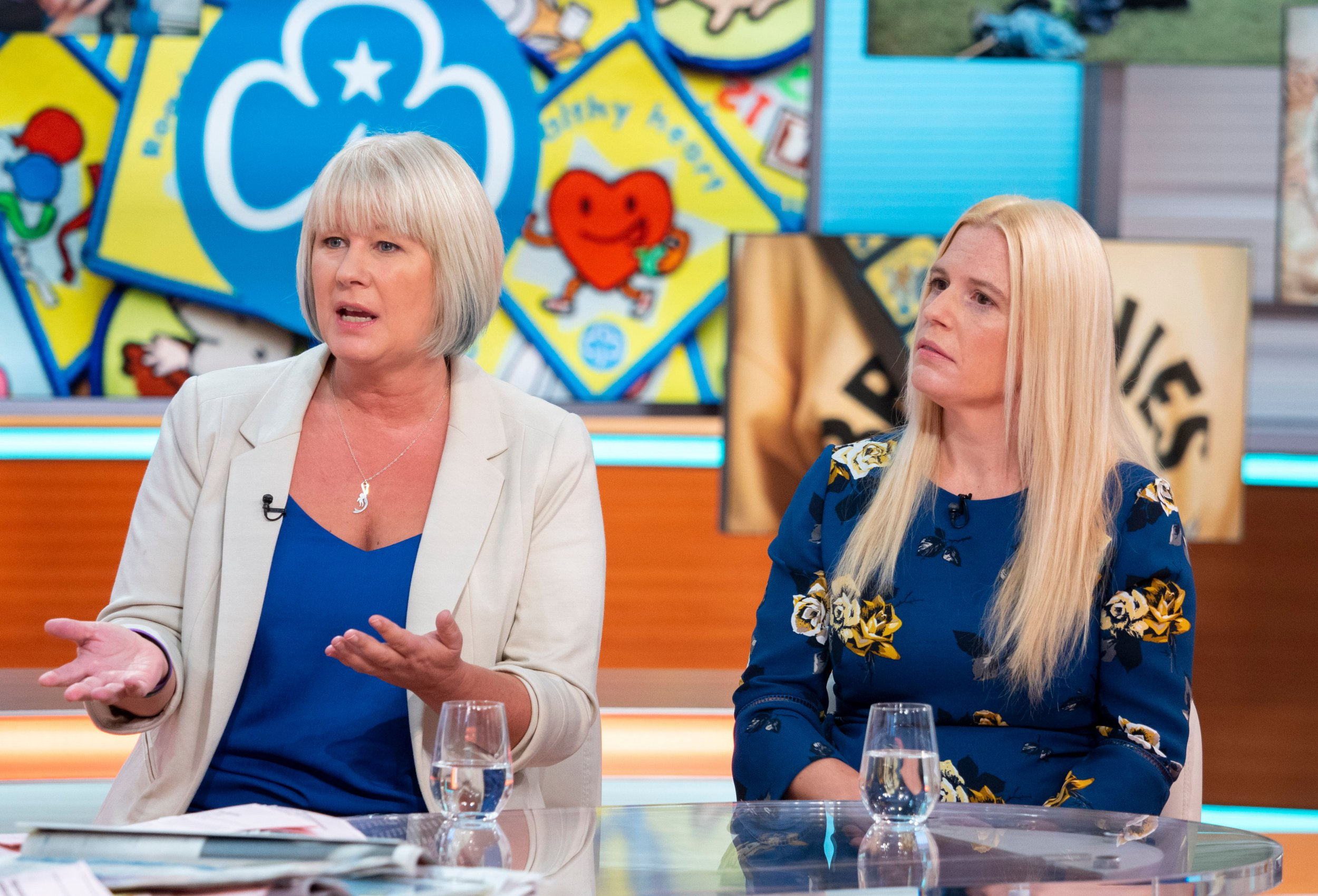 Editorial use only Mandatory Credit: Photo by Ken McKay/ITV/REX/Shutterstock (9894140j) Susie Green and Caroline Farrow 'Good Morning Britain' TV show, London, UK - 25 Sep 2018 GIRL GUIDE TRANSGENDER ROW Two guide leaders who opposed a new policy on transgender girls have been expelled and their local groups closed down. The policy brought in last year has been controversial and says that leaders are not allowed to tell girls or their parents if a girl or leader in their unit used to identify as male - the expelled leaders think this concern with transgender rights conflicts with parents rights. GFX: Guide Leaders' facebook post DESK: Susie Green (Trans activist. The guide leaders are transphobic. Mum of trans girl.) DESK: Caroline Farrow (Catholic mum of 4 girls. Is refusing to let her kids join the guides because of this policy).