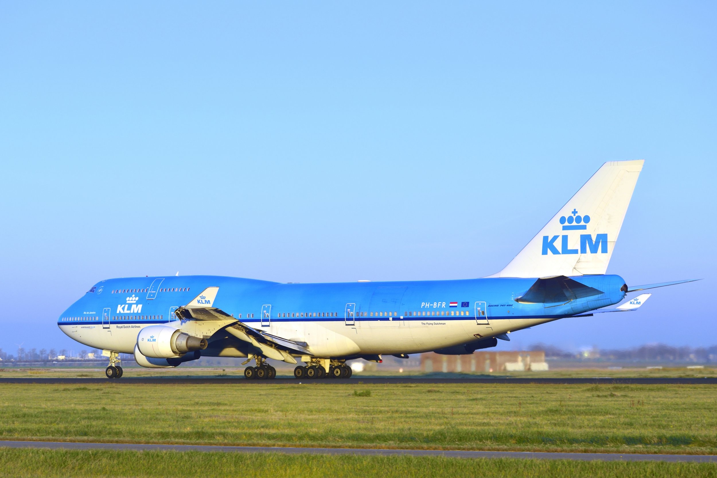 Schiphol, The Netherlands - November 14, 2012: KLM Royal Dutch Airlines Boeing 747-400 taking off from Schiphol Airport in The Netherlands at the end of the day.