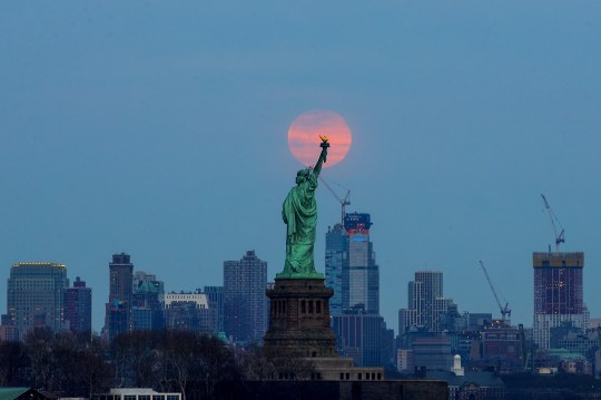NEW YORK, USA - MARCH 20: The last supermoon of 2019 'Super Worm Equinox Moon' rises behind the Statue of Liberty in New York, United States on March 20, 2019. (Photo by Atilgan Ozdil/Anadolu Agency/Getty Images)